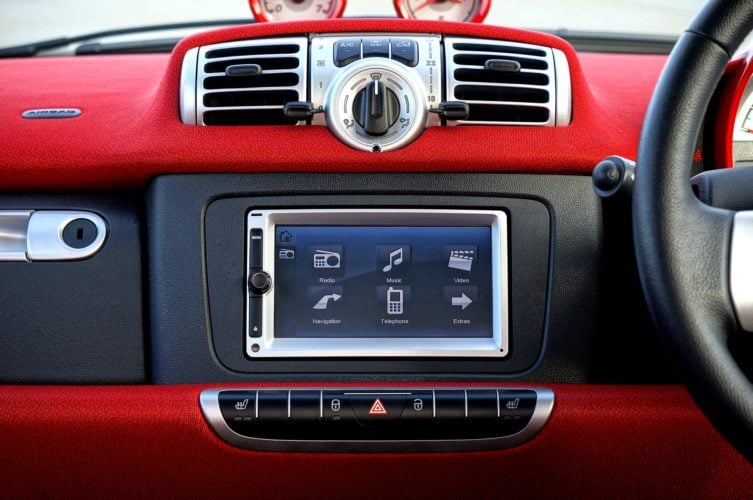 Sat nav system built in to a car dashboard.