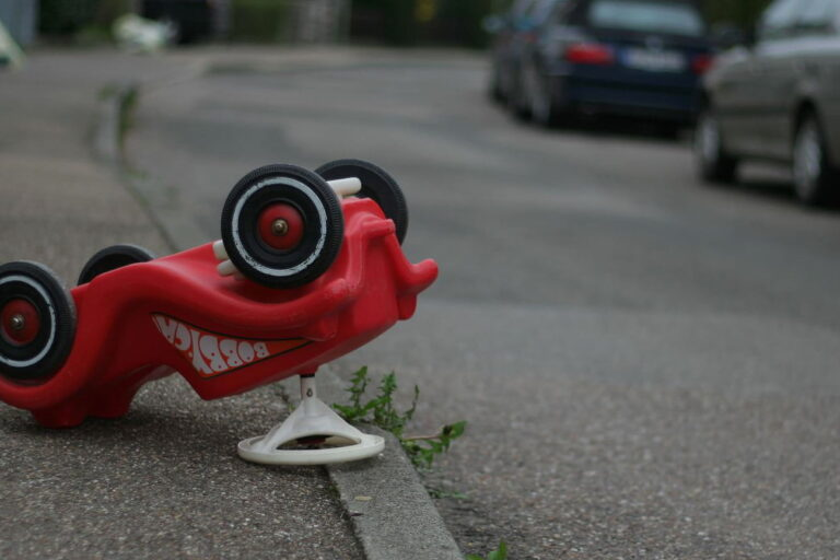An upturned child's Bobby Car. Quality tuition will teach you how to become a safe driver.
