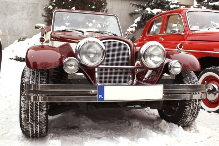 A retro car in the snow -- convertibles are not ideal for winter driving!