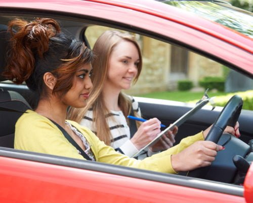 Picture showing a female instructor with a learner driver
