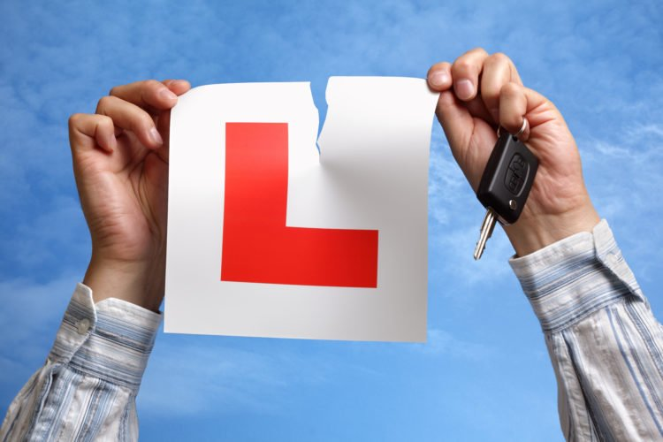 Picture showing man tearing up L-plate
