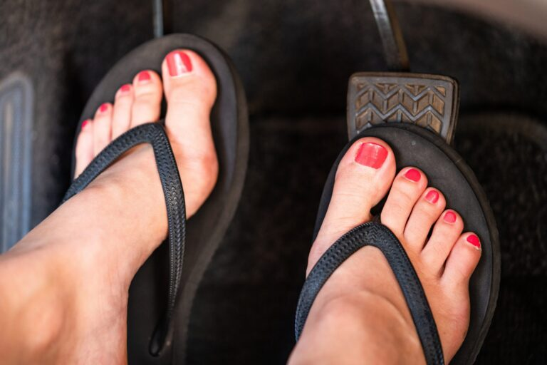 Picture showing someone driving in flip flops