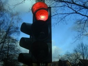 Traffic light displaying a red light, symbolising mistakes made at traffic lights.