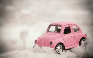 A toy VW Beetle stuck in the snow, symbolising the problems with pulling off in difficult weather conditions.