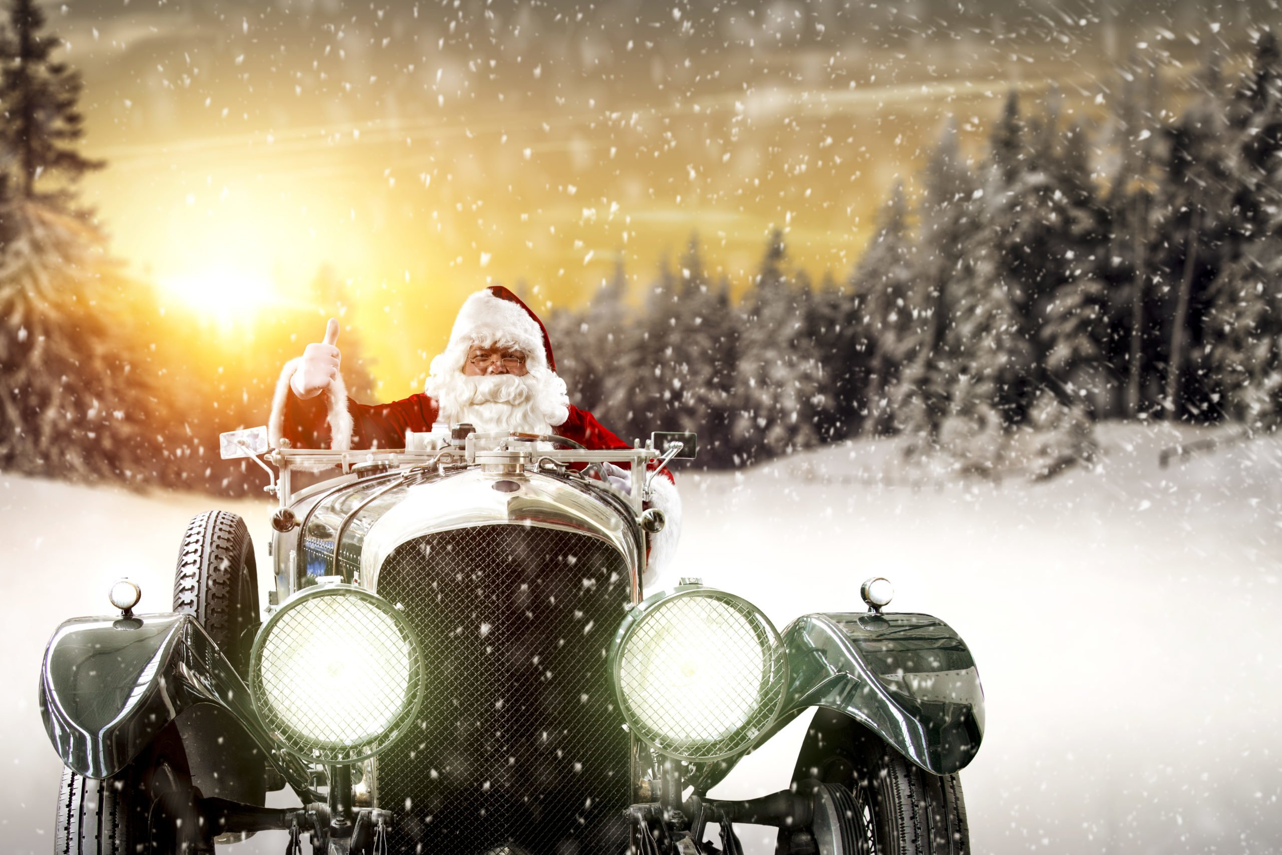 Picture showing Santa driving a car through the snow