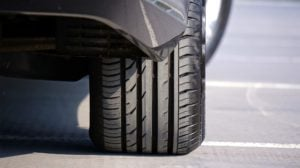 A brand new car tyre, with plenty of tread depth - perfect for driving in winter!