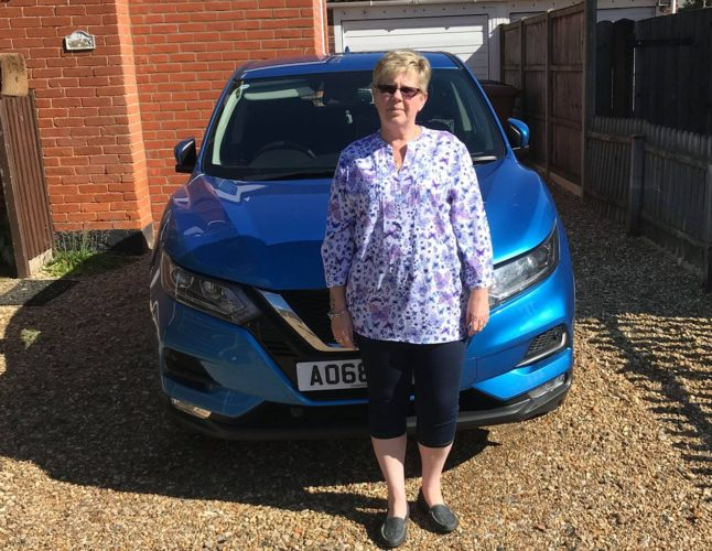 Picture showing former learner Susan Green with the car she bought after passing her test