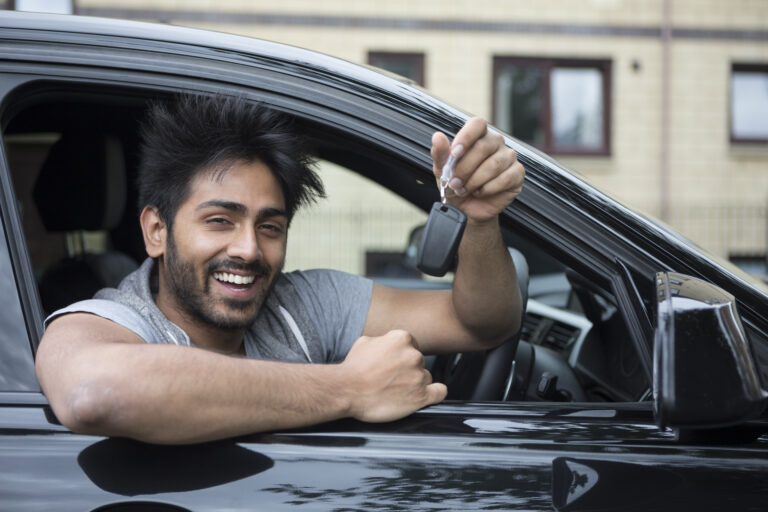 Picture showing driver holding a car key